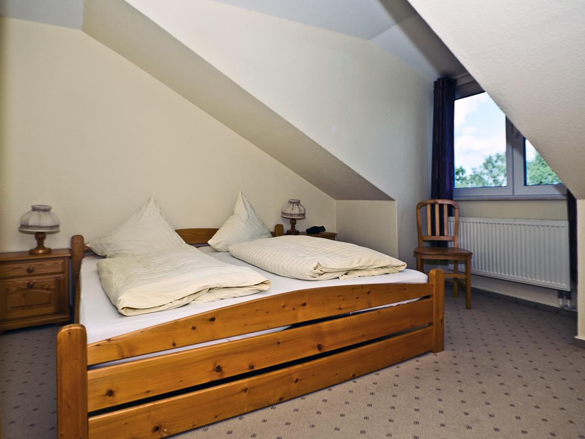 Appartement C - Schlafzimmer