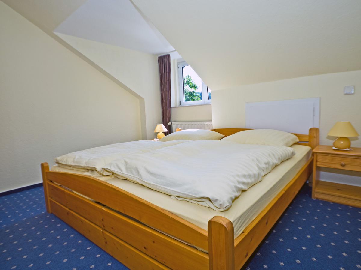 Appartement D - Schlafzimmer